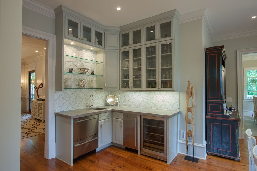 Residential Ice Maker with Traditional Kitchen Also Crown Molding Frame and Panel Cabinets Glass Front Upper Cabinets Glass Shelves Hutch Marble Mosaic Tile Sculpture Stainless Steel Appliances Tile Wall White Cabinets Wood Floor