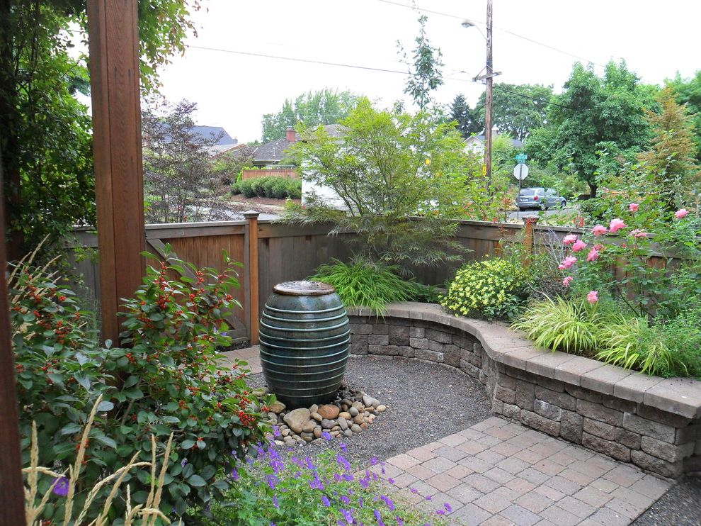 Retaining Walls Omaha Ne with Traditional Landscape  and Bubbler Courtyard Fence Flowers Gravel Lush Pot Rocks Small Stone Stone Wall Tree Wall Water Water Feature