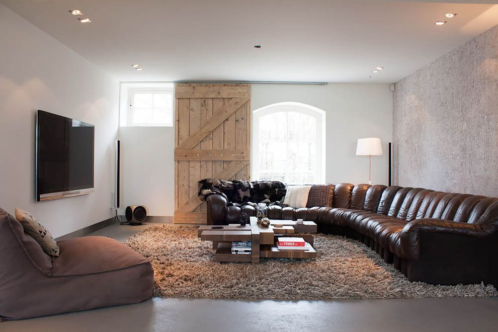 Retractable Tv Ceiling Mount with Contemporary Living Room and Accent Wall Arched Window Batten Door Beige Shag Rug Brown Leather Sofa Large Rug Large Sectional Sofa Leather Sectional My Houzz Puzzle Coffee Table Speaker Textured Wall Wall Mount Tv