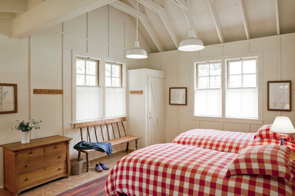 Richardson Lofts   Farmhouse Bedroom Also Barn Lamp Buffalo Plaid Dresser Farm Farmhouse Maps Red Blanket Red Check Bedding Rustic Wood Sloped Ceilings Vaulted Ceilings White Painted Wood Wood Bench
