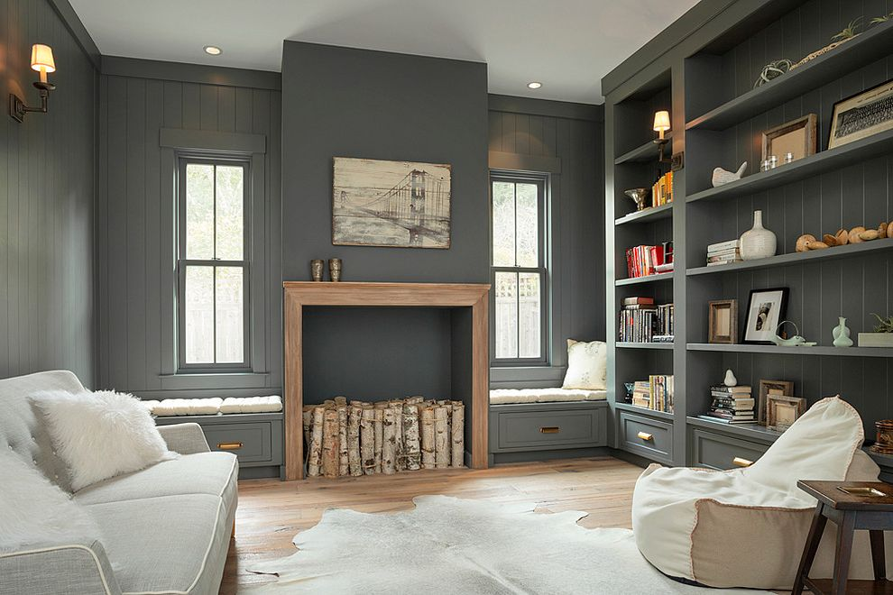 Richardson Lofts   Farmhouse Family Room Also Built in Bookcase Cowhide Rug Cozy Family Room Decorative Fireplace Hide Rug Wall Shelving Warm Gray Window Seats