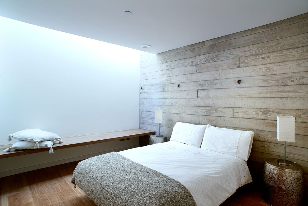 Right at Home Bedford Ma with Modern Bedroom Also Daylight Floating Bench Guys Bedroom Indirect Light Metallic Side Table Natural Light Oak Floor Skylights Table Lamps Textured Concrete Wall White Bedding Wood Bench Wood Panel Wood Panel Wall