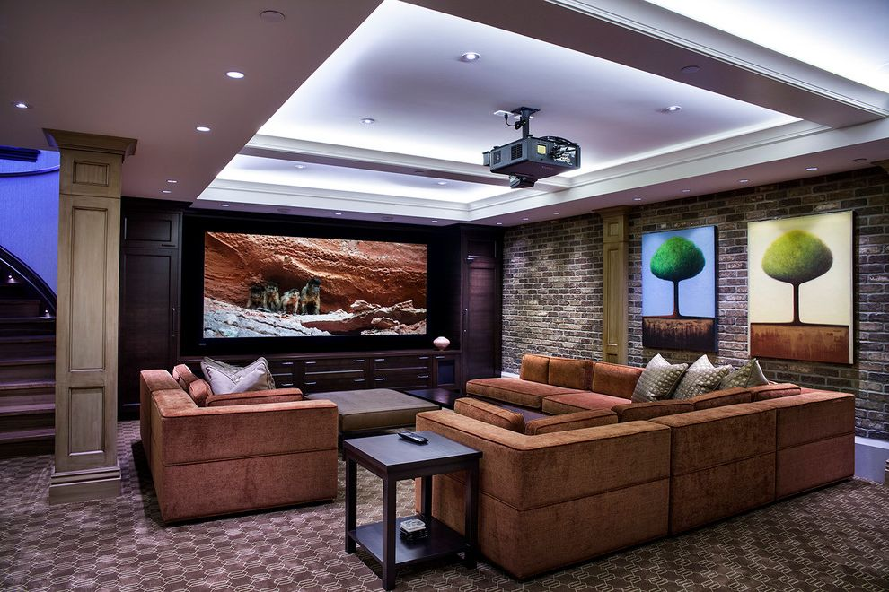 Right at Home Bedford Ma with Transitional Home Theater  and Brick Walls Built in Cabinets Carpeting Cove Lighting Dark Stained Wood Frame and Panel Millwork Post Recessed Lighting Rust Sofa Sectional Sofas Tray Ceiling