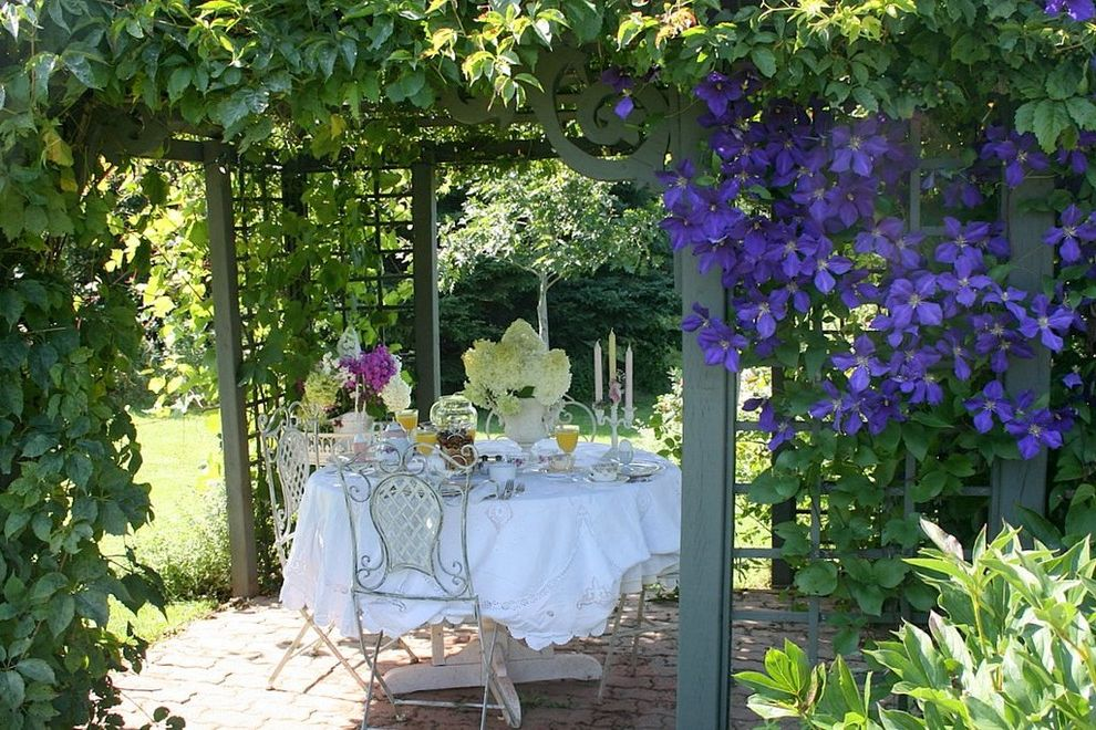 Right Away Disposal   Traditional Patio Also Arbor Brick Paving Centerpiece Floral Arrangement Grass Hydrangea Iron Furniture Lawn Outdoor Dining Outdoor Entertaining Patio Furniture Pegola Pergola Table Setting Tablecloth Trellis Turf Urn