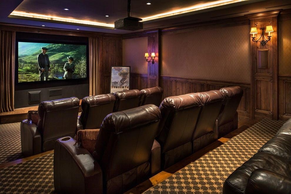 Rio Rancho Theater   Craftsman Home Theater Also Cove Lighting Curtains Family Friendly Home Theatre Seating Leather Chairs Movie Room Projector Tiered Wall Sconces Wood Paneling