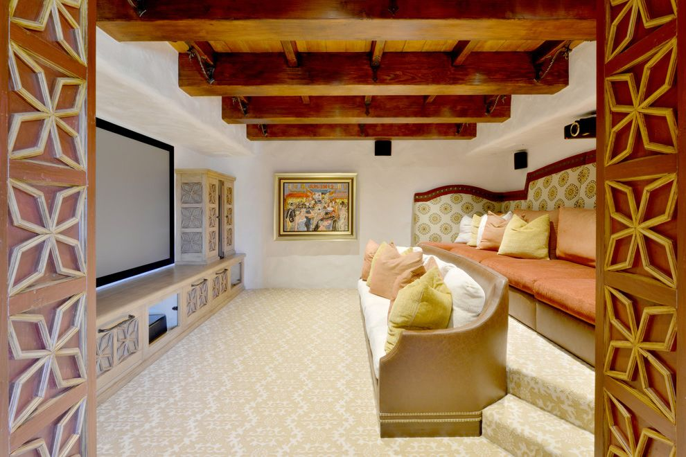 Rio Rancho Theater   Mediterranean Home Theater  and Beige and White Carpet Built in Seating Decorative Panel Cabinet Exposed Beams Large Artwork Projector Wall Mounted Screen White Walls