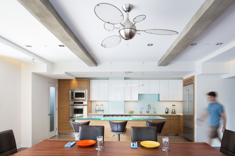 Rittenhouse Electric with Contemporary Kitchen and Bar Seating Cement Beams Contemporary Ceiling Fan Contemporary Kitchen Crocodile Embossed Leather Chairs Exposed Beams Glass Island Glass Table Top Hardwood Flooring Pop of Color Plates White Cabinets