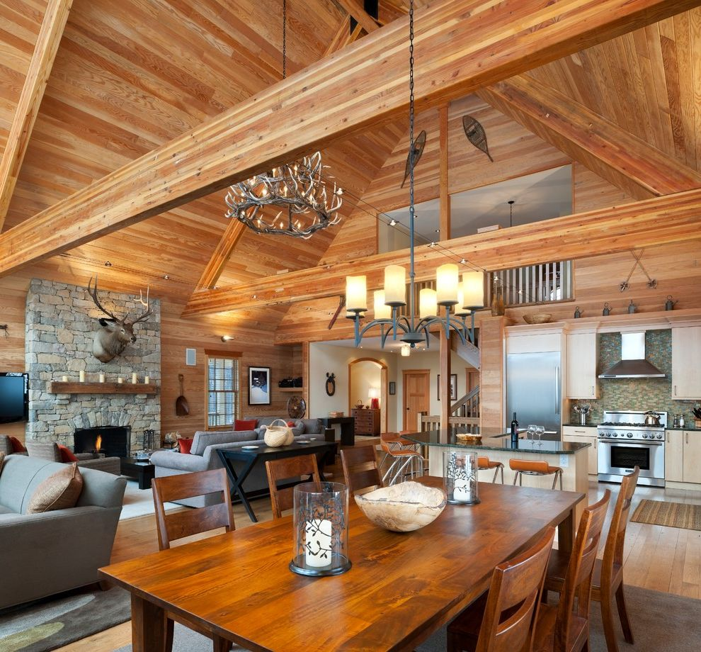Rittenhouse Electric with Rustic Dining Room and Beam Cabin Chandelier Fireplace Kitchen Lodge Natural Wood Open Plan Rustic Stone Stone Fireplace Track Light Vaulted Ceiling Wood Wood Beam Wood Table