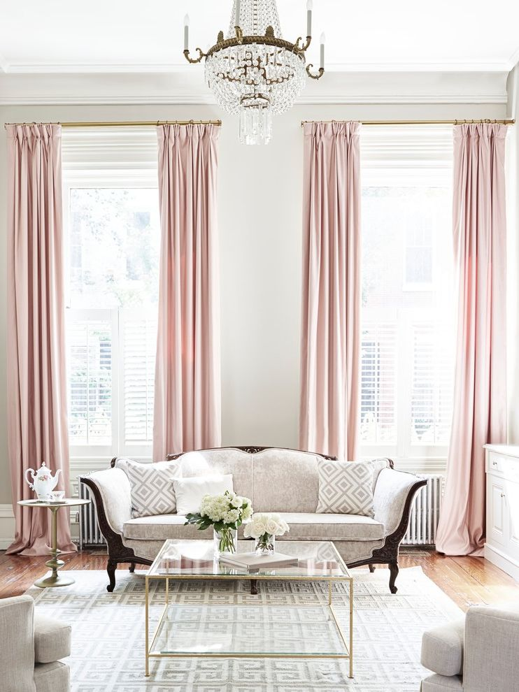 Rittenhouse Electric with Traditional Living Room and Brass Coffee Table Brass Curtain Rod Crystal Chandelier Feminine Spaces Gold Accents Grey and White Pink Curtains Tall Ceilings Tall Curtains Velvet Sofa