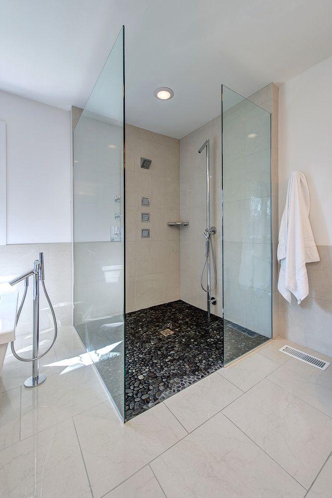 Rock Solid Floors   Contemporary Spaces Also Black and White Bath Curbless Shower Frameless Shower Enclosure Jet Sprays Modern Bathroom No Threshold Shower Oversized Shower Pebble Tile Shower Tile Spa Bath White Floor
