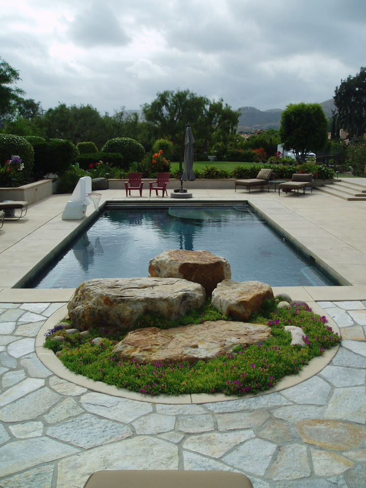 Rock Solid Stone Center   Contemporary Pool  and Boulder Desert Flagstone Flowers Garden Stairs Garden Wall Hedges Lounge Chair Mountain View Pool Pool Basketball Hook Rock Stone Umbrella Xeriscape