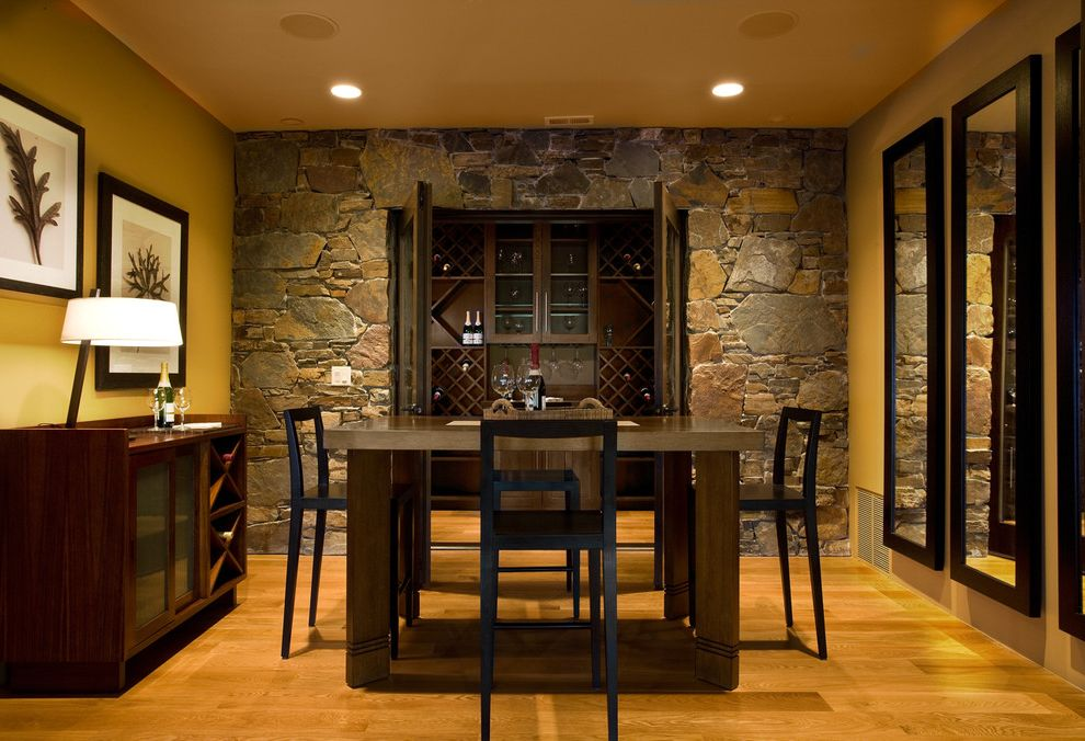 Rock Solid Stone Center   Rustic Dining Room Also Asian Barstool Cabinet Cabinet with Wine Storage Mirror Rustic Stone Wall Table Traditional Wine Cellar Wine Storage Wood Floor Yellow Walls