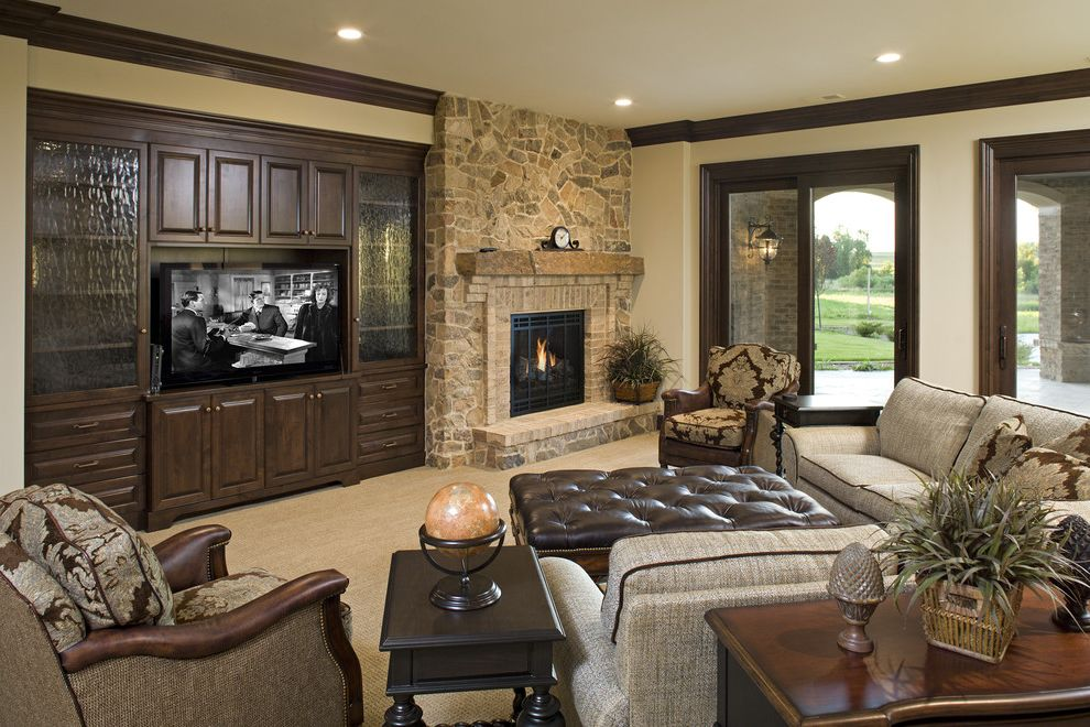 Rock Solid Stone Center with Traditional Family Room Also Crown Molding Entertainment Center Fireplace Mantel Media Storage Stone Fireplace Surround Tan Carpet Tufted Leather Ottoman