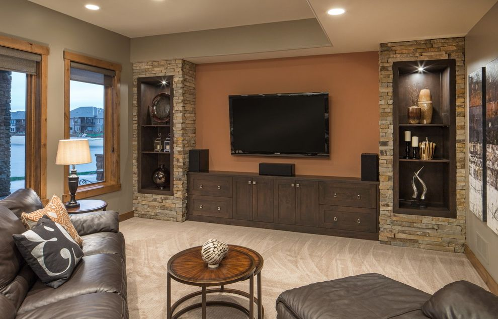 Rock Solid Stone Center with Transitional Family Room Also Built in Niches Carpeting Leather Sofa Nesting Tables Orange Accent Wall Pillows Recessed Lighting Roller Blinds Stone Veneer Table Lamps Taupe Walls Tv Wall Art Wood Casing