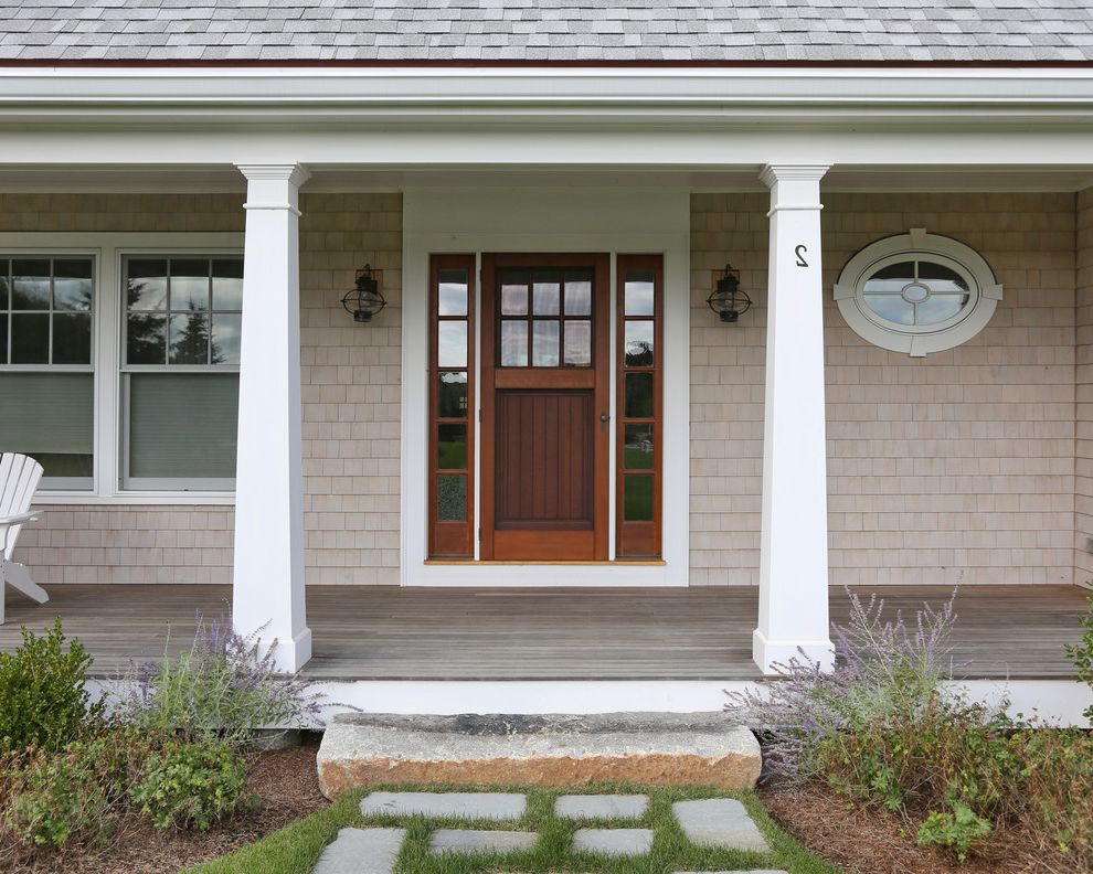 Rogue Valley Doors with Beach Style Entry Also Columns Covered Porch Front Door Front Porch Granite Step Oval Window Porch Lights Shingle Siding Sidelights Stepping Stones Tapered Columns White Columns Wood Door Wood Shingles