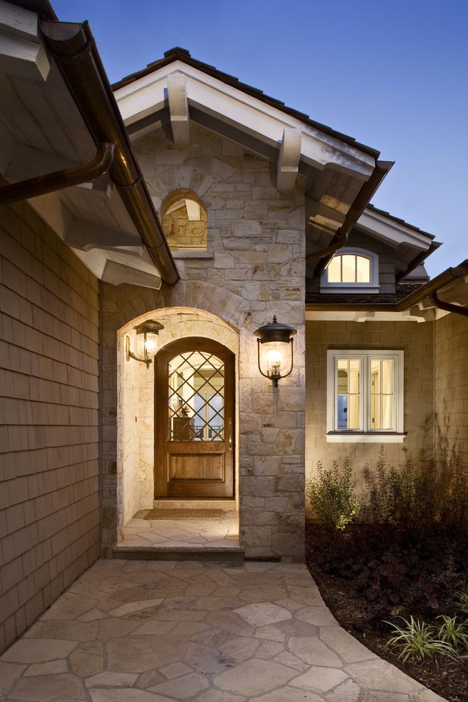 Rogue Valley Doors with Contemporary Entry  and Eaves Lantern Outdoor Lighting Overhang Porch Rock Wall Sconce Shingle Siding Stone Paver Wall Lighting White Wood Wood Door Wood Trim