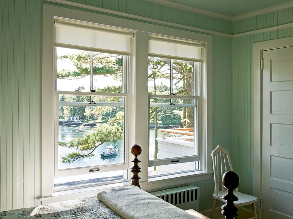 Roll Down Window Shades with Beach Style Bedroom  and 5 Paneled Door Antique Chair Beadboard Coastal Cottage Four Poster Maine Mint Green New England Quilt Radiator Vintage Water View Waterfront Window Wood Bed