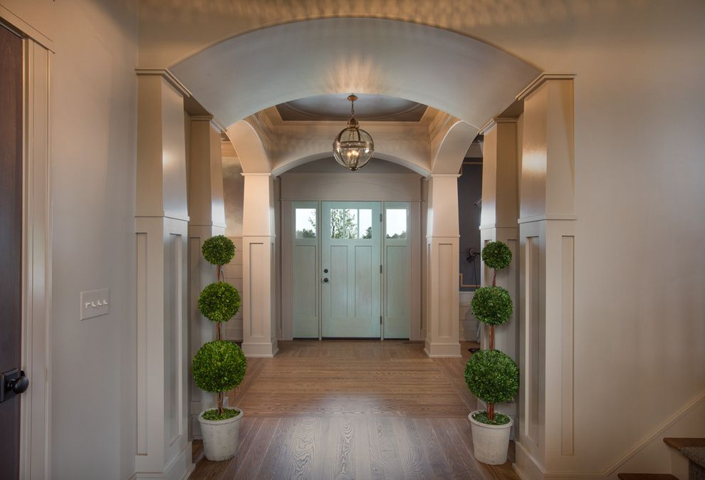 Romanelli and Hughes   Transitional Entry  and Arches Coastal Columns Contemporary Wood Floor Craftsman Frame and Panel Hardwood Floor Horizontal Plank Masculine Panel Parade Home Pendant Light Restoration Hardware Side Lights Topiary