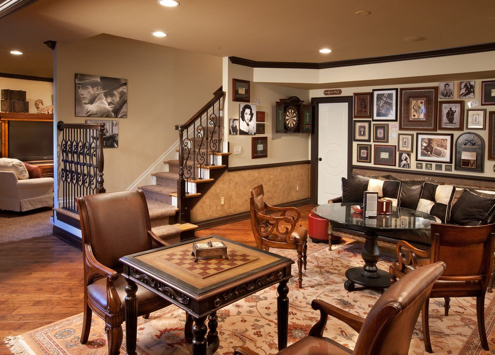 Romanelli and Hughes with Mediterranean Basement  and Black Crown Molding Black Pedestal Table Brown Leather Chair Card Table Carved Wood Checkerboard Table Chess Table Filagree Game Room Glass Overlay Wrought Iron Balustrade