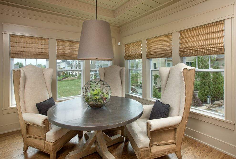 Romanelli and Hughes with Transitional Dining Room Also Beige Breakfast Room Cream Fabric Shade Morning Room Pendant Lights Roman Shades Tongue and Groove Ceiling Tray Ceiling Upholstered Chairs Wing Back Chairs Wood Floor