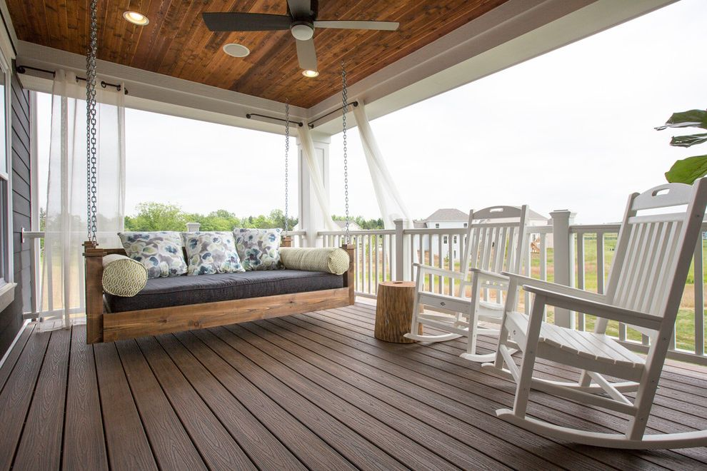 Romanelli and Hughes with Transitional Porch  and Bench Swing Bolsters Ceiling Fan Chains Covered Porch Custom Lap Siding Pillows Porch Swing Rocking Chairs Swing Veranda White Painted Wood Wood Ceiling Wood Railing