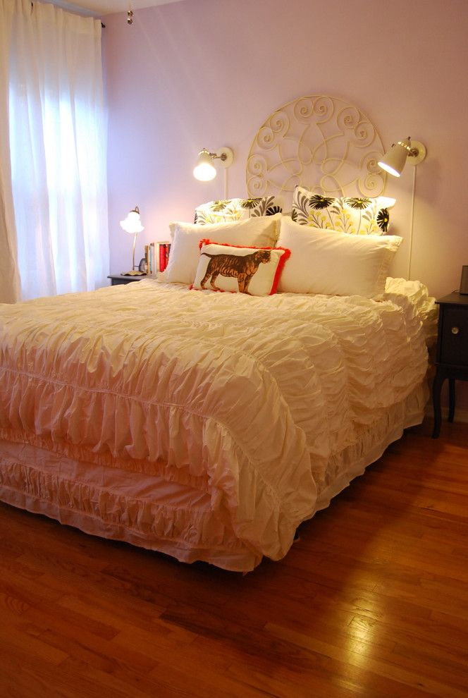 Romantic Comforters with Eclectic Bedroom  and Bed Pillows Curtains Decorative Pillows Drapes Gathered Ornate Headboard Reading Lamp Sconce Throw Pillows Wall Lighting White Bedding Window Sheers Window Treatments Wood Flooring