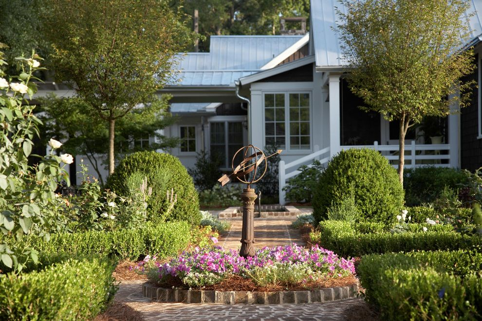 Roof Center Baltimore   Farmhouse Landscape Also Brick Path Garden Path Garden Statue Groomed Hedges Metal Roof Orb Pink Flowers Roses Round Flower Bed Small Trees