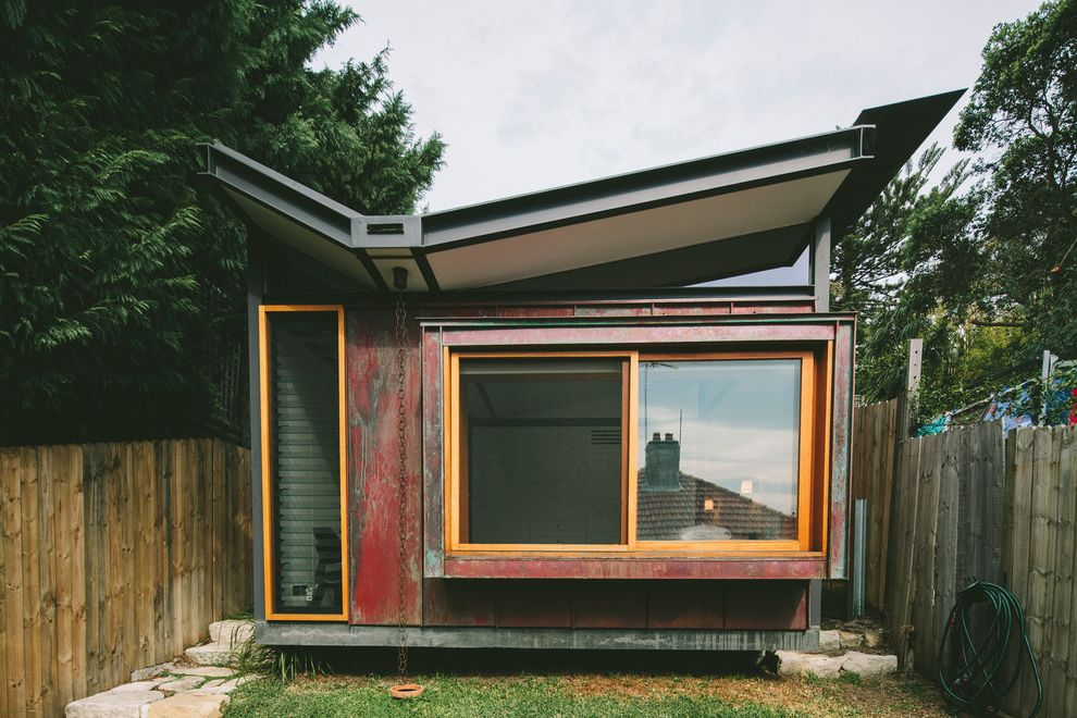 Roof Center Baltimore with Contemporary Exterior  and Butterfly Roof Clerestory Concrete Copper Distressed Paint Glass Glass Louvers Lawn Narrow Lot Rain Chain Red Sliding Window Steel Stepping Stones Timber Wood Casing Wood Fence Zen