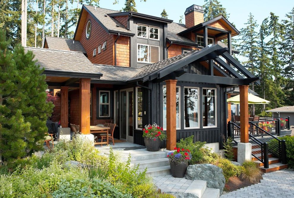 Roof Shingle Colors with Rustic Exterior Also Boulders Cabin Cable Railing Container Plants Dark Trim Entrance Entry Outdoor Steps Potted Plants Rocks Shed Dormer Shingle Siding Split Level Terraced