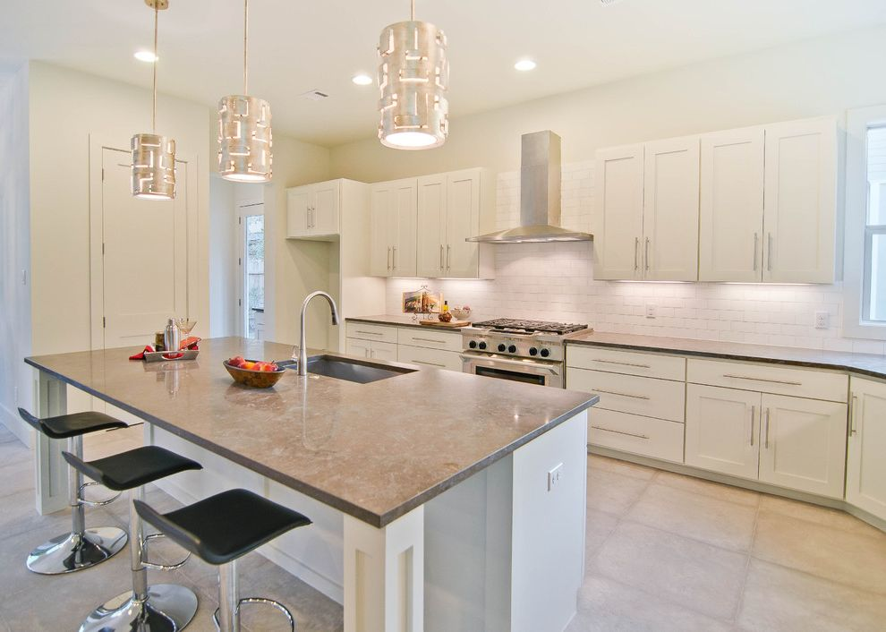 Roof Vent for Range Hood   Transitional Kitchen  and Backsplash Counter Stools Gray Counters Hood Island Pendant Lamps Recessed Panel Cabinets Stainless Appliances Subway Tile White Cabinets White Tile Floor