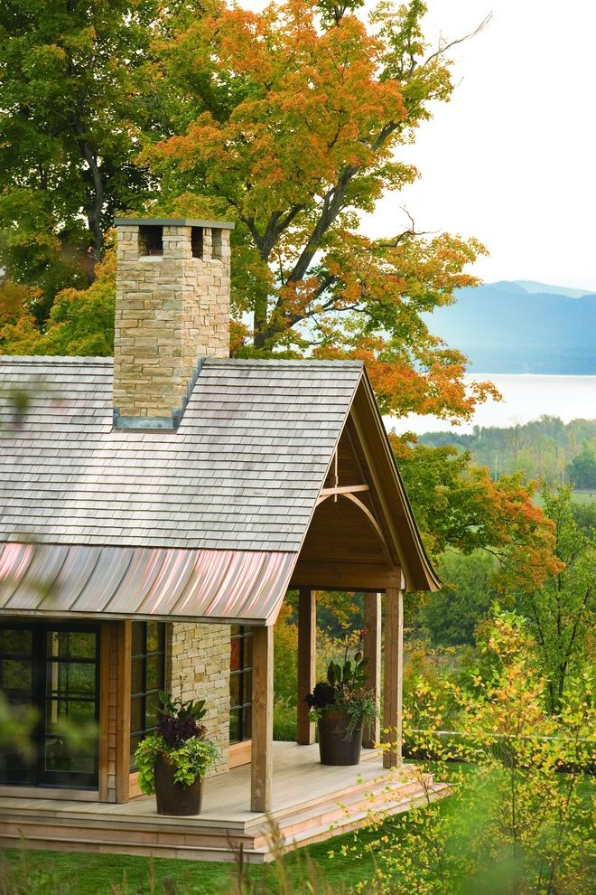 Roofing Shingles Cheap with Rustic Exterior  and Cabin Container Plants Copper Roof Exposed Beams Gabled Roof Grass Lawn Metal Roof Porch Potted Plants Rustic Shake Roof Stone Chimney Stone Wall Turf View Wood Columns Wood Posts