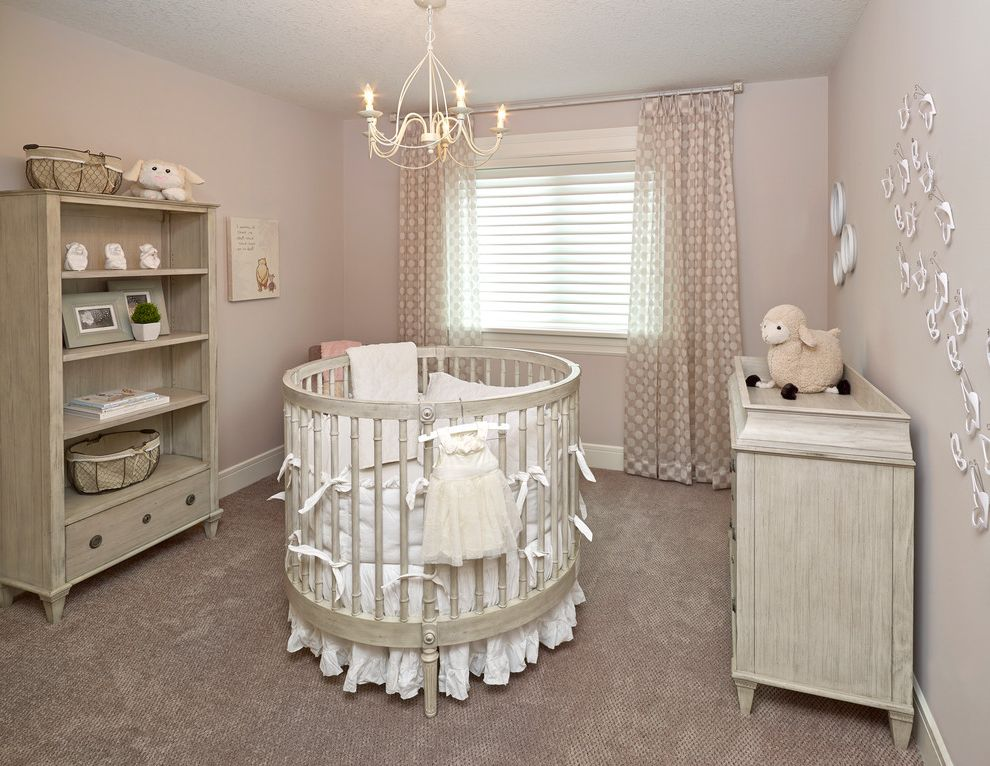 Rooms to Go Cribs with Transitional Nursery and Baseboard Beige Carpeting Chandelier Changing Tables Nursery Round Crib Sheer Curtains Soft White Distressed Paint Window Sheers