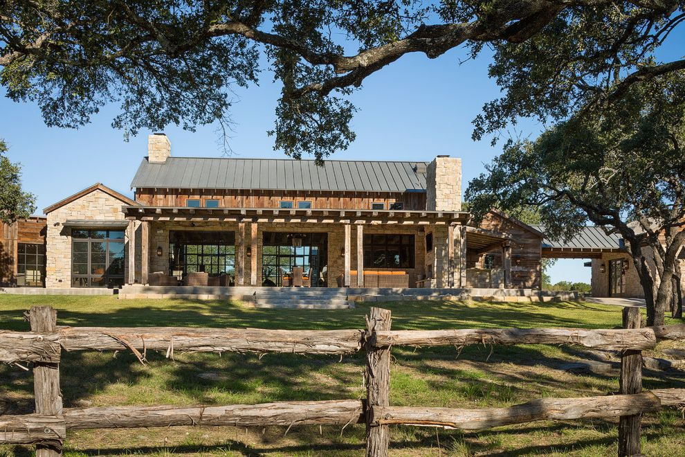 Rough Country Rustic Furniture with Rustic Exterior Also Awning Back Porch Breezeway Exposed Beams Gable Roof Porch Steps Portico Ranch Rough Hewn Wood Split Rail Fence Standing Seam Metal Roof Stone Chimney Transom Window Wicker Patio Furniture