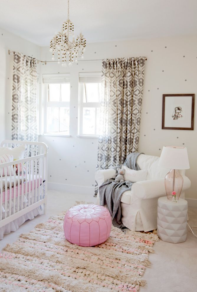 Round Pink Rugs for Nursery with Eclectic Nursery Also Pink Accents Pink Pouf Small Chandelier Wallpaper White Crib White Glider
