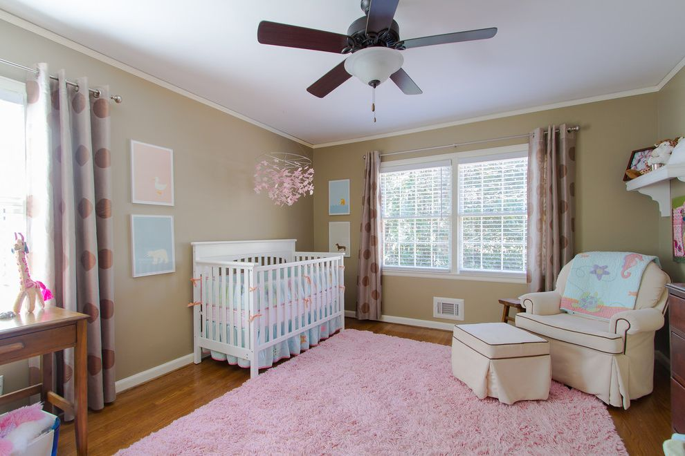 Round Pink Rugs for Nursery with Traditional Nursery  and Arm Chair Ceiling Fan Crip Pink Pink Rug Window Treatment Wood Floor