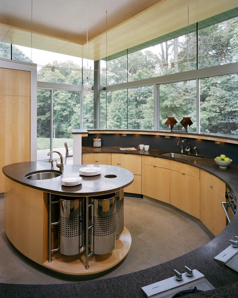 Round Top Antique Show with Contemporary Kitchen  and Black Countertop Curved Cabinets Curved Island Floor to Ceiling Windows Kitchen Island Prep Sink Pendant Light Wall of Windows