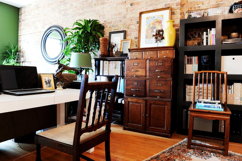 Rta Office Cabinets with Eclectic Home Office  and Black Bookshelves Color Eclectic Exposed Brick Global Houseplant Round Mirror Tribal Vintage Wood File Cabinet Wooden Chairs Yellow Vase