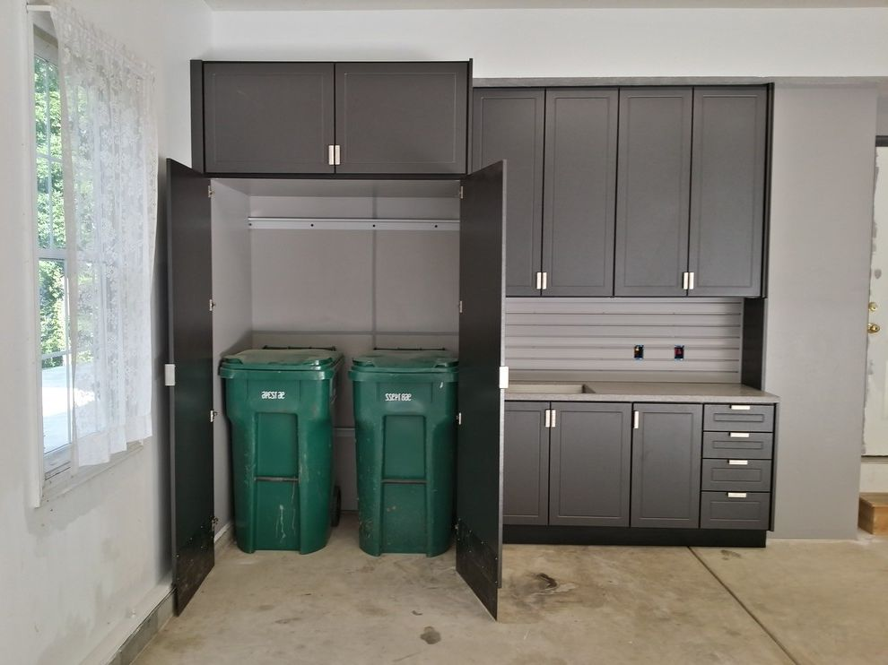 Rubbermaid Garbage Cans   Industrial Garage  and Concrete Floor Contemporary Garage Dark Wood Cabinets Garage Tool Storage Garage Cabinets Garage Storage Lots of Storage Tool Garage Storage Tool Storage Tv in Garage Work Shop Workshop