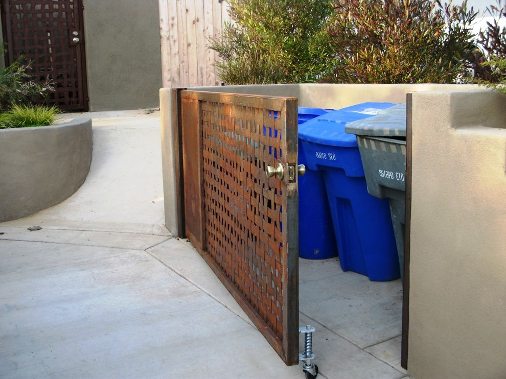 Rubbermaid Garbage Cans   Mediterranean Landscape Also Driveway Rusted Metal Gate Trash Enclosure Utility Woven Metal