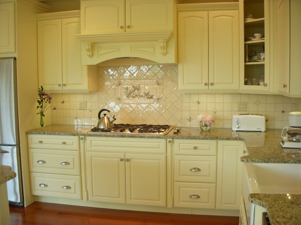Ruby & Quiri with Traditional Kitchen  and Tile Backsplash and Mirage Hardwood Floo