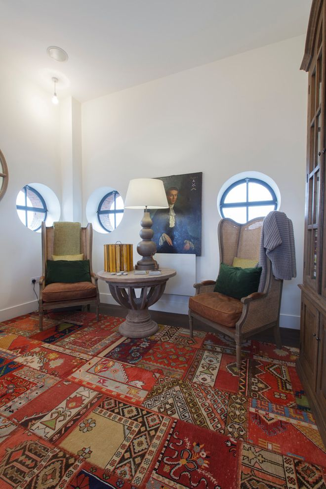 Rug and Home Asheville   Eclectic Home Office Also Armoire Hutch Leather Seat Cushions Patchwork Area Rug Portrait Painting Rattan Wingback Chairs Red Round Windows Turkish Patchwork Rug Velvet Pillows White Walls
