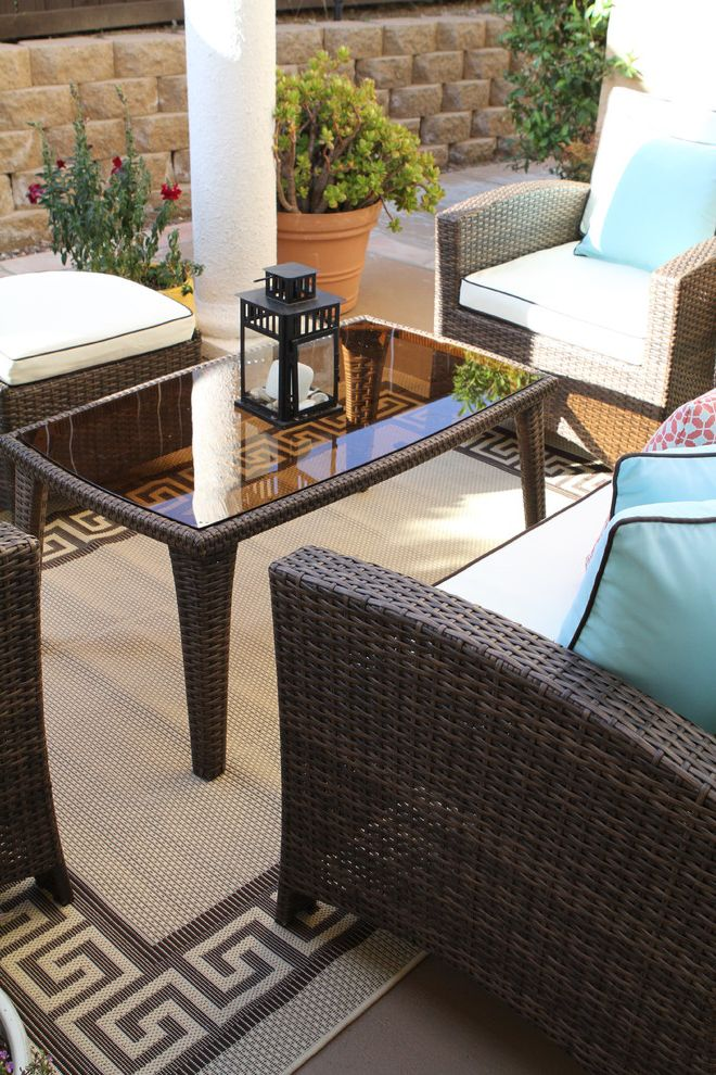 Rugs at Home Depot with Traditional Patio  and Area Rug Colorful Hanging Lanterns Colorful Orange and Turquoise Pillows Cream and Brown Lounge Furniture Outdoor Living Space Umbrella Wall Sunburst