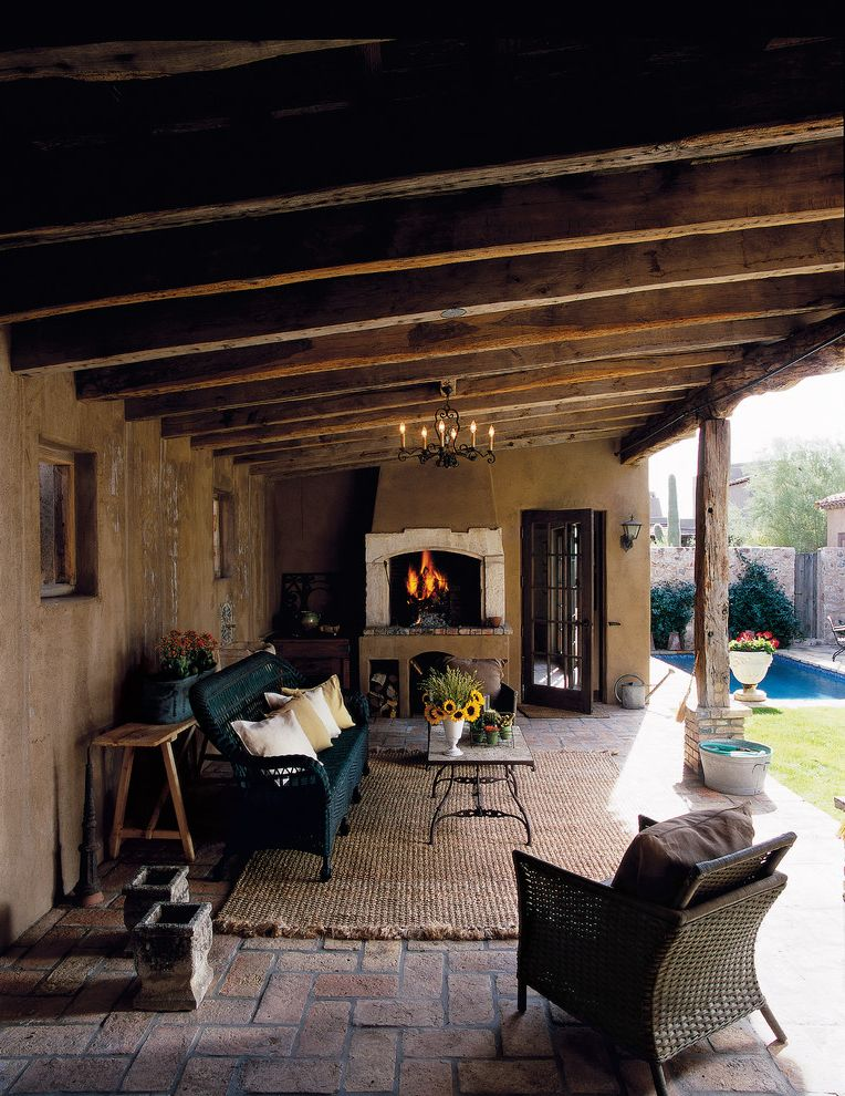 Rustic Duvet Covers with Traditional Patio Also Covered Porch Outdoor Fireplace Outdoor Seating Pool Rustic Slanted Roof Stucco Tile Floor Wicker Furniture Wood Beams Woven Area Rug Woven Seating