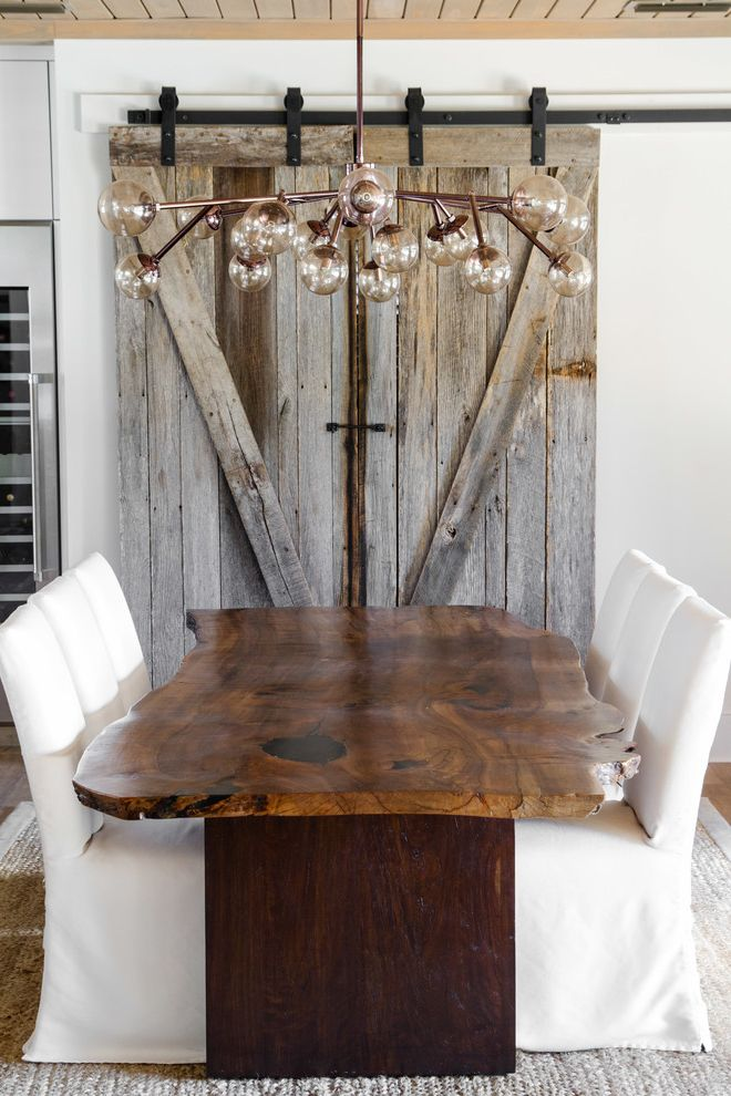 Ruth's Chris Jacksonville   Beach Style Dining Room  and Area Rugs Dining Chairs Live Edge Dining Table Modern Light Fixture Natural Finishes Natural Materials Rustic Wood Sliding Barn Doors Slipcover