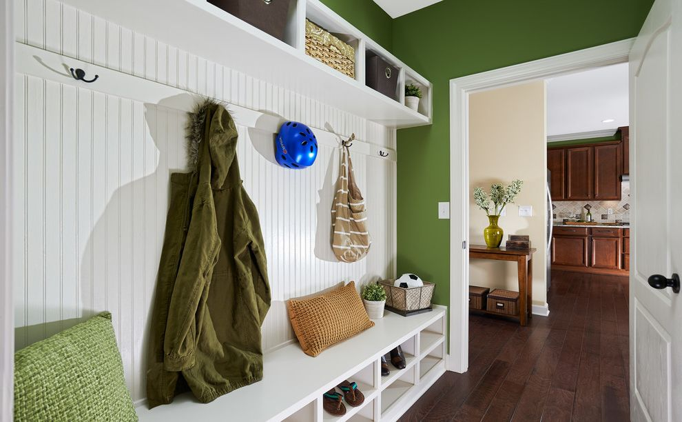 Ryan Homes Charlotte Nc   Traditional Entry  and Beadboard Paneling Bench Black Hardware Built in Shelf Closet Cubbies Cushions Floating Shelf Green Painted Wall Hallway Hardwood Floor Hooks Mud Room White Door White Door Casing