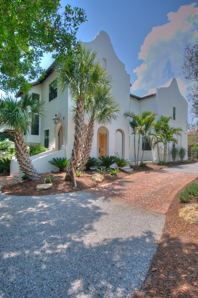 Sago Palm Care with Mediterranean Exterior Also Archway Brick Driveway Entrance Entry False Front Front Door Gravel Driveway Palm Trees Roof Line Stucco Tropical
