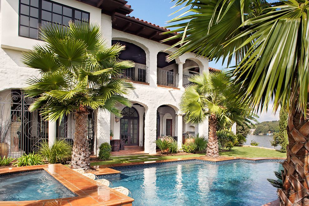 Sago Palm Care with Mediterranean Pool  and Archway Balcony Covered Patio Grass Hacienda Hot Tub Jacuzzi Lake Lakehouse Lawn Outdoor Living Palm Trees Pavers Pool Pool Tiles Spa Tile Roof Turf View Waterfront