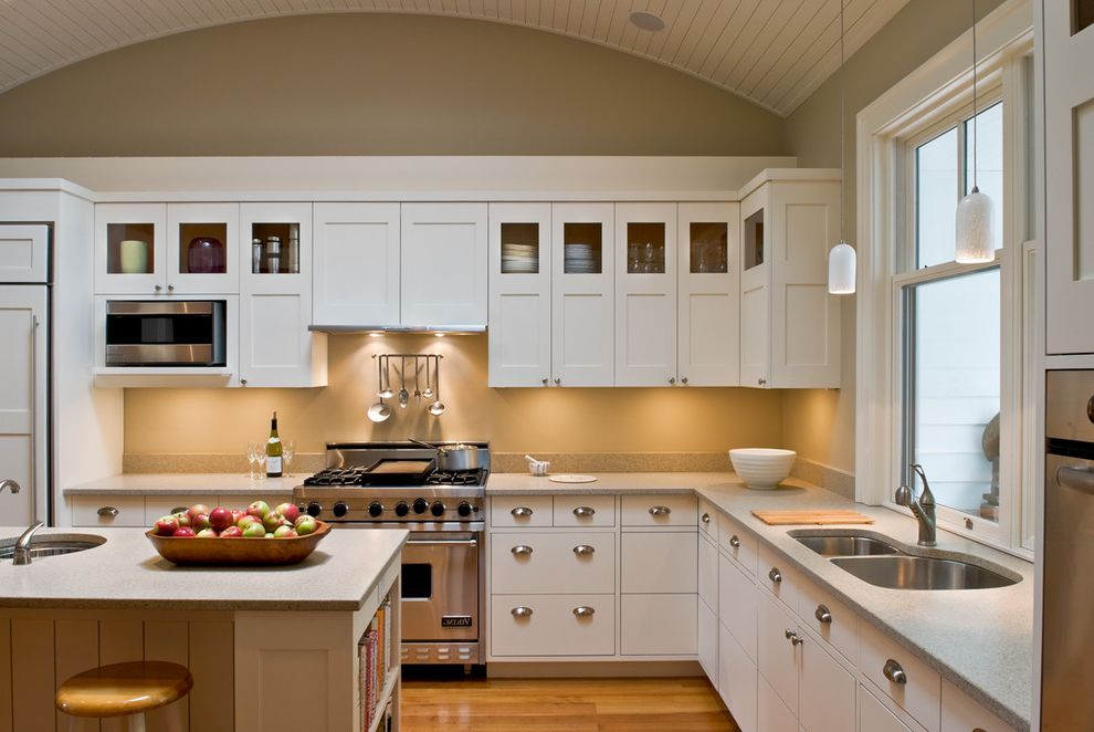 Salamander Cabinets   Farmhouse Kitchen Also Barrel Vault Ceiliing Counter Stools Drawer Pulls Glass Front Uppers Gray Counters Integrate Kitchen Pendant Lights Stainless Steel Appliances White Wood Floor