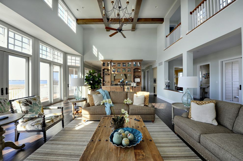 Salt Spray Sheds with Traditional Living Room Also Area Rug Blue Glass Lamp Ceiling Fan Chandelier Clerestory Windows Coffee Table High Ceiling Light Blue Walls Striped Rug Tan Couch Tan Sofa