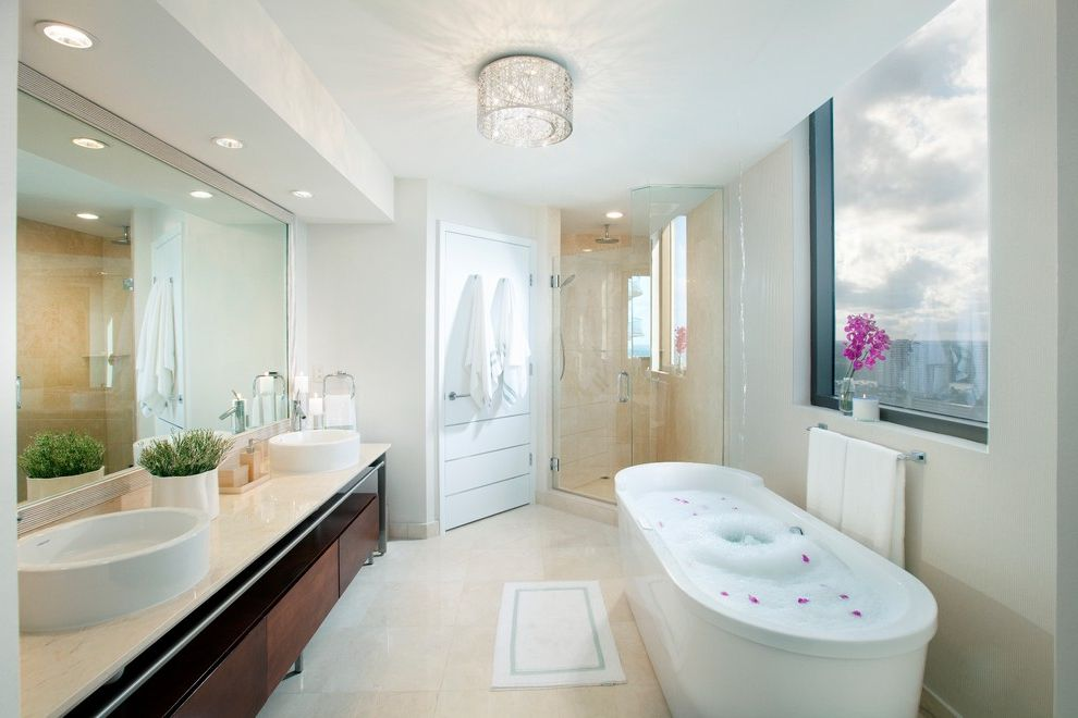 Satin Nickel Light Fixtures   Contemporary Bathroom  and Bath Mat Ceiling Light Dark Stained Wood Double Vanity Freestanding Bathtub Glass Shower Enclosure Large Windows Mirror Recessed Lights Soffit Tile Floor Towel Hooks Vessel Sinks White Walls